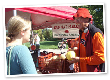 Farmer Mike Hessel sells melons at the Corvallis Farmers' Market